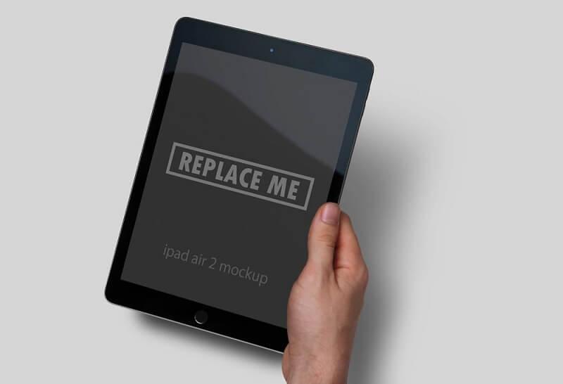 Black iPad in Hand