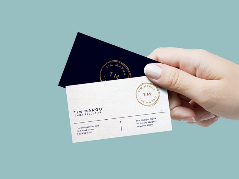 Hand Holding Business Cards