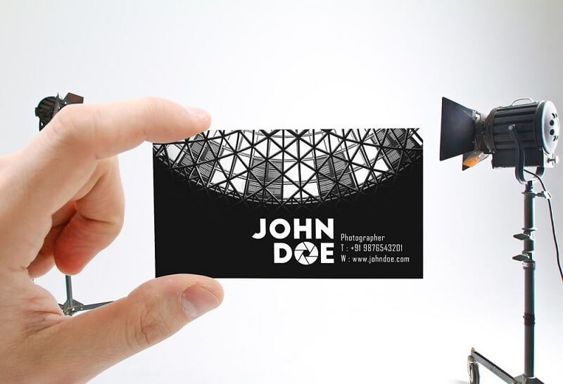 Male Hand holding Business Card