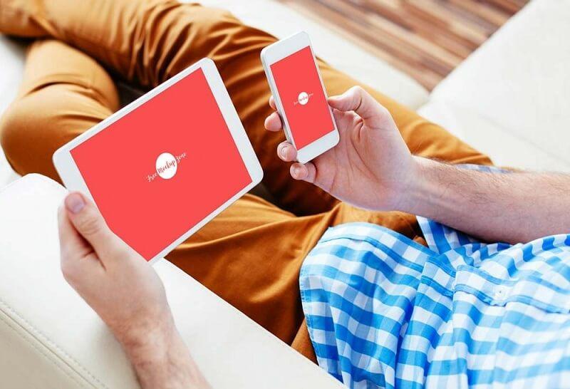 Man checking his iPad and iPhone
