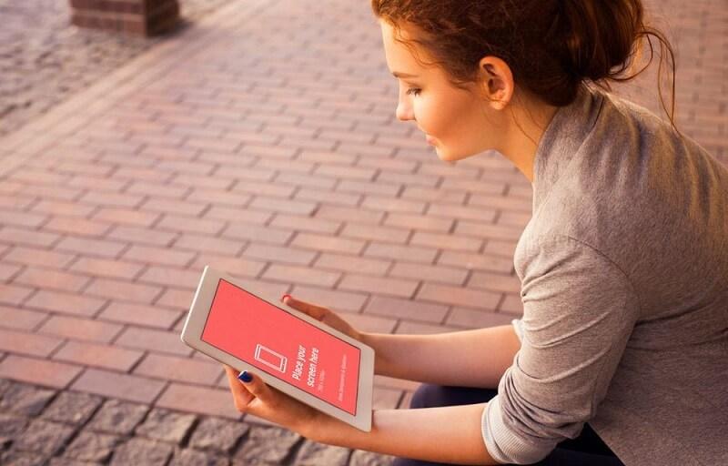 Young Woman looking at iPad